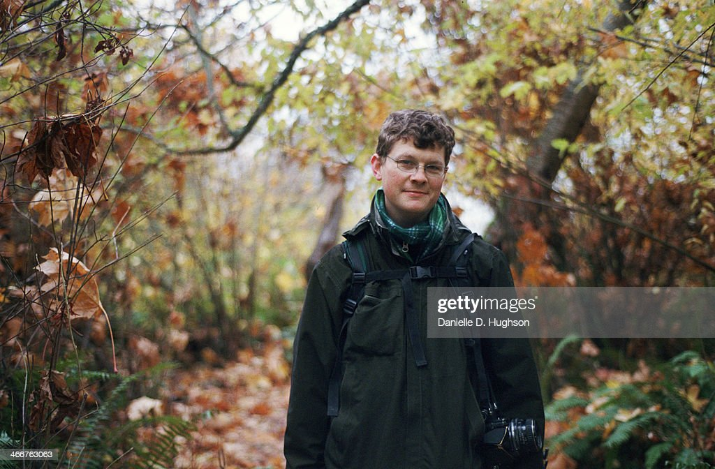 Photographer Standing on Trail  with Fall Colors : Stock Photo