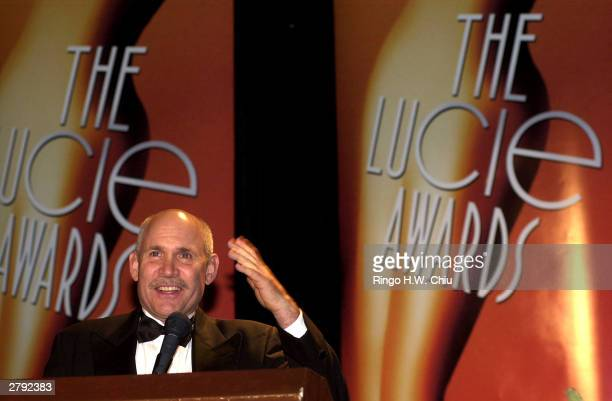 Photographer Steve McCurry speaks on the stage as he accepts the Outstanding Achievement in Photojournalism award at The 2003 International...