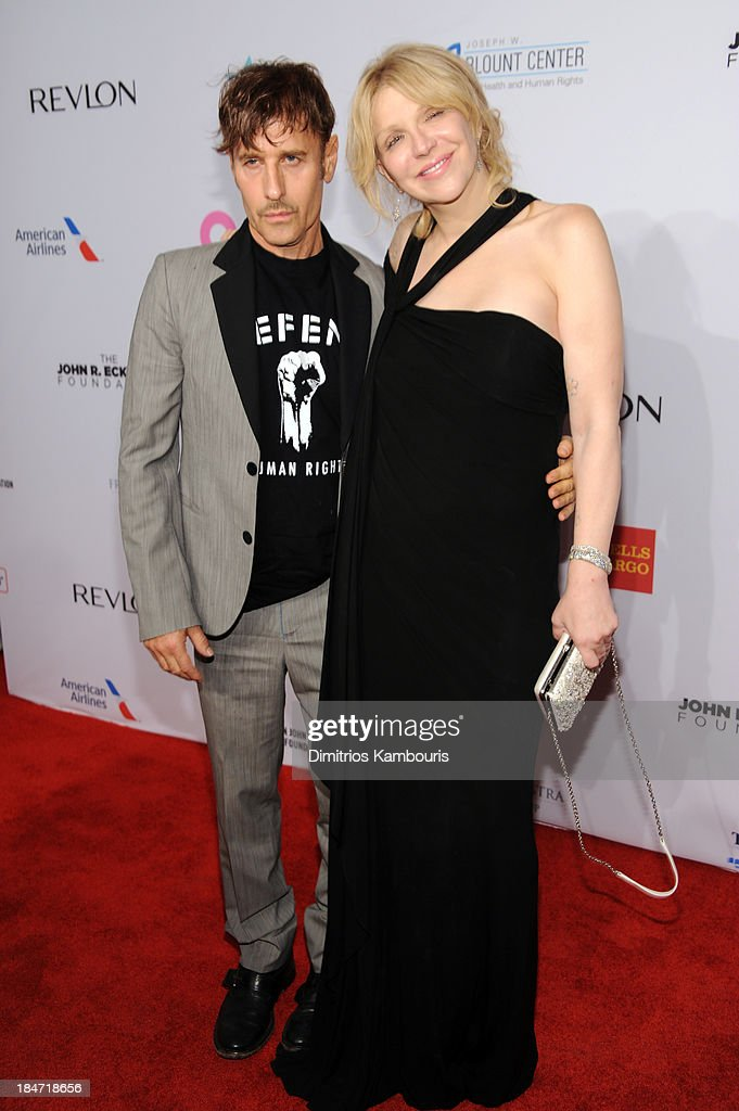 Photographer Steven Klein (L) and Courtney Love attend the Elton John AIDS Foundation's 12th Annual An Enduring Vision Benefit at Cipriani Wall Street on October 15, 2013 in New York City.
