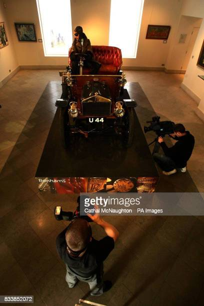 A photographer take pictures of the worlds oldest surviving Rolls Royce car no 20154 built in 1904 on display at Bonhams in London The vehicle is a...