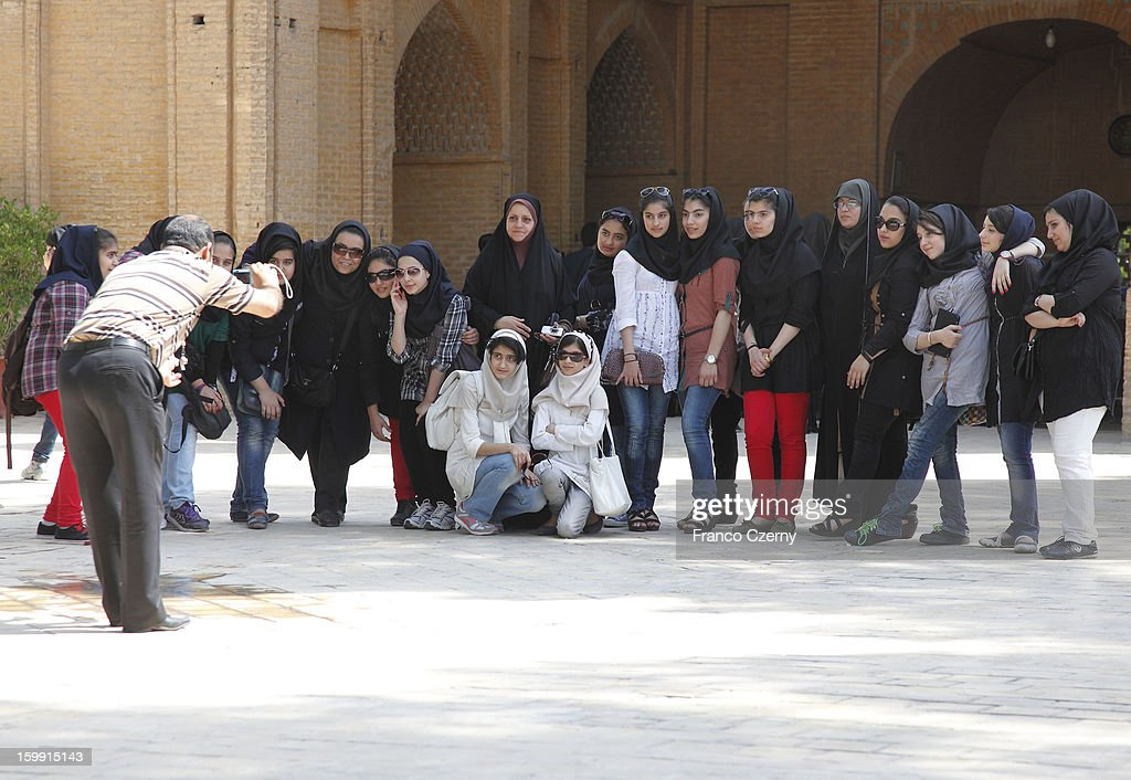 A photographer takes a group photo of young iranian women on August 17, 2012 in Isfahan, Iran.