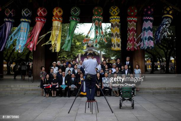 A photographer takes a group photograph during the Mitama Matsuri summer festival at Yasukuni Shrine on July 13 2017 in Tokyo Japan The fourday...