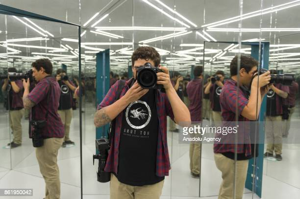 A photographer takes a photo inside of the Vortex tunnel an exhibition part of the Museum of Illusions in Vienna Austria on October 16 2017 The...