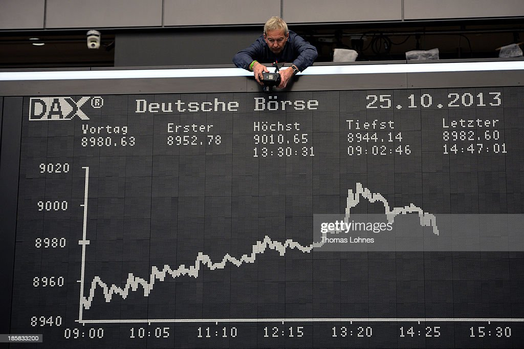 A photographer takes a photo of the day's performance board of the DAX stock market index not long after the DAX broke the 9,000 level at the Frankfurt Stock Exchange on October 25, 2013 in Frankfurt, Germany. Today's level sets a new record for the DAX, which is the main German stock market index.