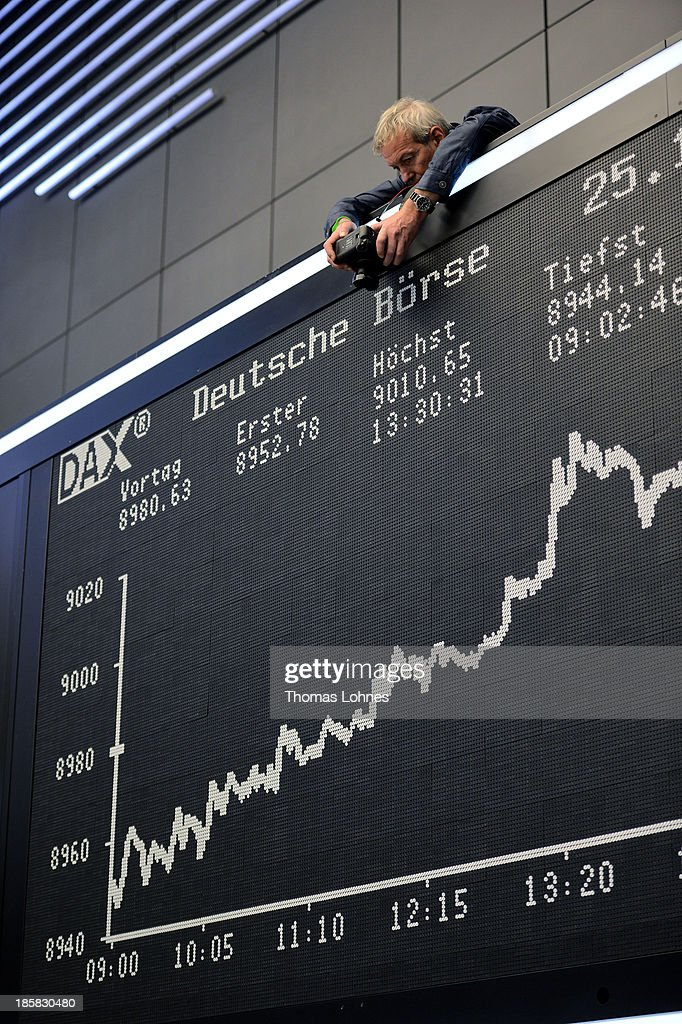 A photographer takes a photo of today's performance board of the DAX stock market index not long after the DAX broke the 9,000 level at the Frankfurt Stock Exchange on October 25, 2013 in Frankfurt, Germany. Today's level sets a new record for the DAX, which is the main German stock market index.
