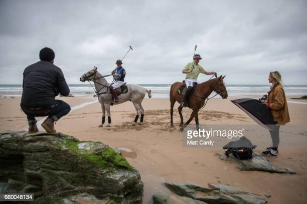 A photographer takes a photograph as Andy Burgess riding Tonka and Daniel Loe riding La Sofia practice for the forthcoming Aspall Polo on the Beach...