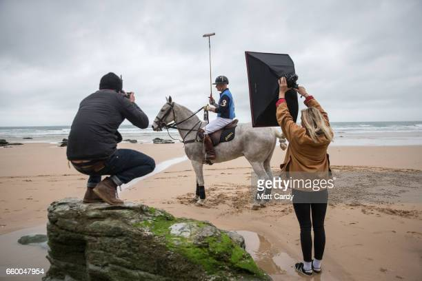 A photographer takes a photograph as Andy Burgess riding Tonka practice for the forthcoming Aspall Polo on the Beach at Watergate Bay on March 29...