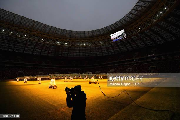 A photographer takes a picture during an official media tour of the Luzhniki Stadium on December 1 2017 in Moscow Russia
