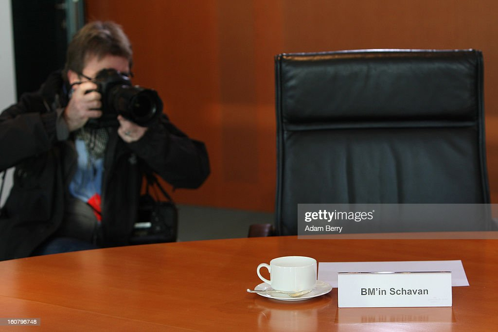 A photographer takes a picture of the empty seat of German Education Minister Annette Schavan prior to the weekly German government cabinet meeting on February 6, 2013 in Berlin, Germany. The University of Dusseldorf retracted Schavan's doctoral degree on Tuesday evening after the institute decided that she plagiarized portions of it while a student 30 years ago, making her the latest in a series of German politicians in the past two years to lose such a degree due to insufficient annotation.