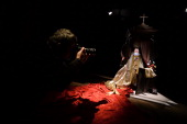 A photographer takes a picture of 'Unspeakable act' a wax figurine Pope Benedict XVI inside a confessional by Italian artists Antonio Garullo and...