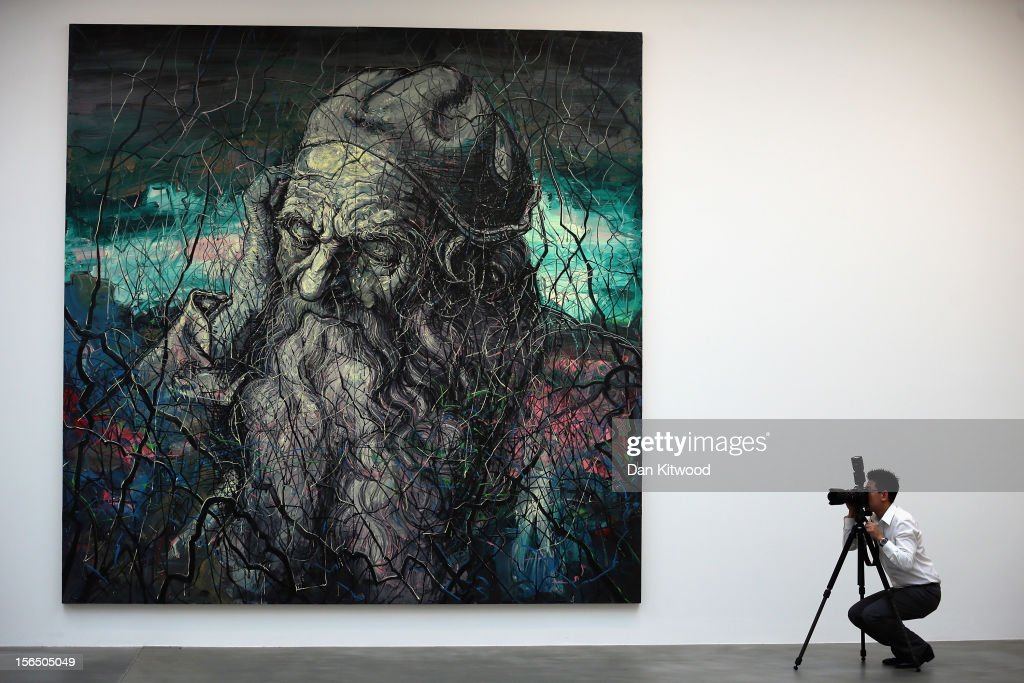 A photographer takes pictures in front of a painting entitled 'Head of an Old Man' during an exhibition preview of work by contemporary artist Zeng Fanzhi on November 16, 2012 in London, England. The piece makes up part of Zeng Fanzhi 's first solo show in the UK, and runs at the Gagosian Gallery until January 19, 2013.