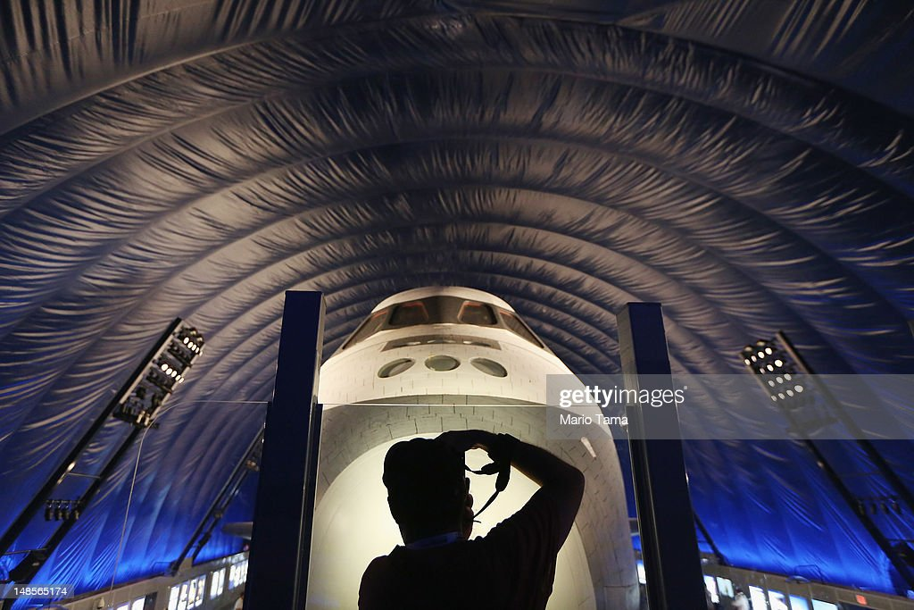 A photographer takes pictures in front of The Space Shuttle Enterprise at a press preview of the Intrepid Sea, Air & Space Museum's new Space Shuttle Pavilion on July 18, 2012 in New York City. The Enterprise was NASA's first space shuttle and a prototype which performed tests in 1977 within the Earth's atmosphere. NASA awarded the Enterprise to the museum after the 2011 retirement of the shuttle program. The pavilion will open to the public July 19.