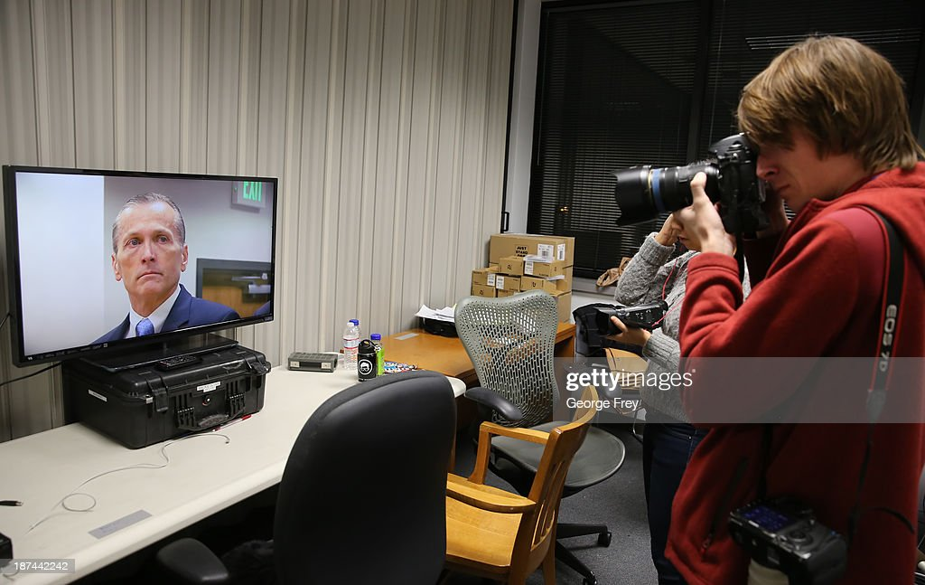 A photographer takes pictures of a TV screen displaying Martin MacNeill's reaction to the guilty verdict for the murder of his wife Michele MacNeill and obstruction of justice on November 9, 2013 in Provo, Utah. Martin MacNeill was found guilty of murdering his wife Michele MacNeill in 2007 and will face up to life in prison when he is sentenced in January.