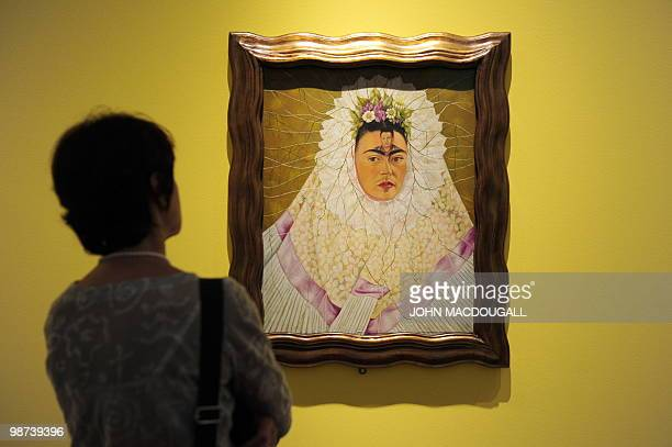A photographer takes pictures of the painting 'SelfPortrait as Tehuana or Diego on My Mind' by Mexican artist Frida Kahlo during a press preview on...
