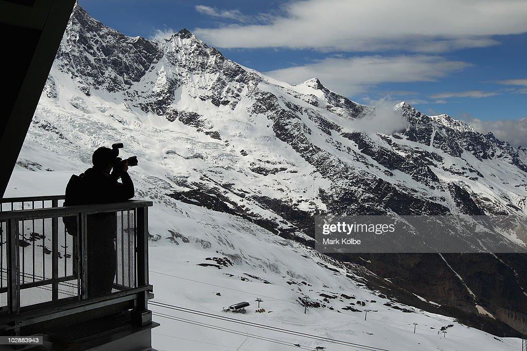 A photographer takes pictures of the view from Felskinn lift station on June 2, 2010 in Saas-Fee, Switzerland.