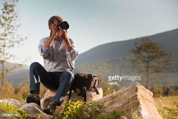 Fotógrafo de tomar una fotografía