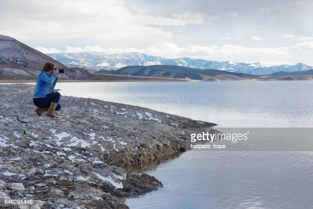 Photographer taking a picture at Piute Reservoir in Utah.