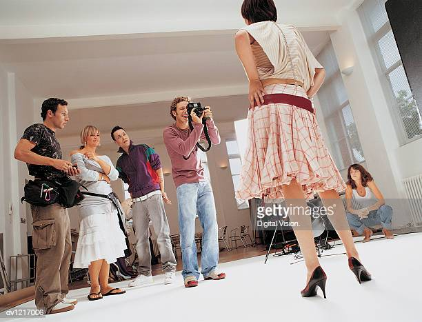 Photographer Taking a Picture of a Fashion Model at a Photo Shoot