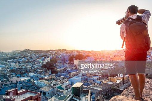 Photographer taking image of the Blue City rooftops, Jodhpur