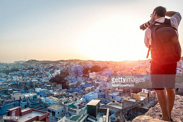 Photographer taking image of the Blue City rooftops, Jodhpur