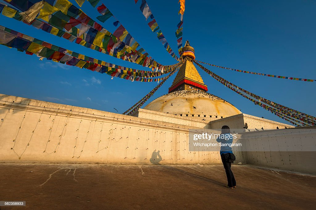 A photographer taking photo of Boudhanath stupa