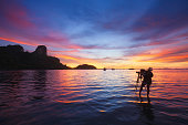Photographer taking photo of sunrise at East Railay Bay Beach - Krabi, Thailand