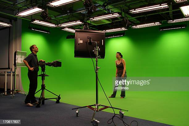 Photographer taking photos in film studio