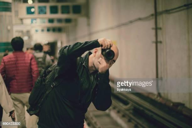 Photographer taking photos in Istanbul, Turkey metro