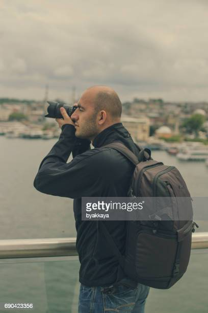 Photographer taking photos in Istanbul, Turkey