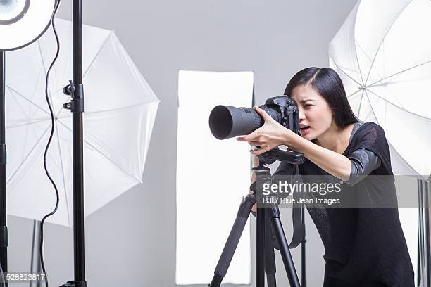 Photographer taking picture in studio