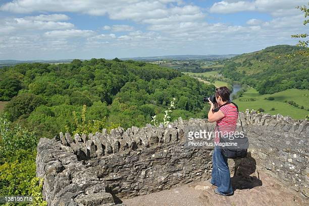 A photographer taking pictures from a raised viewpoint in the Forest of Dean taken on May 31 2011