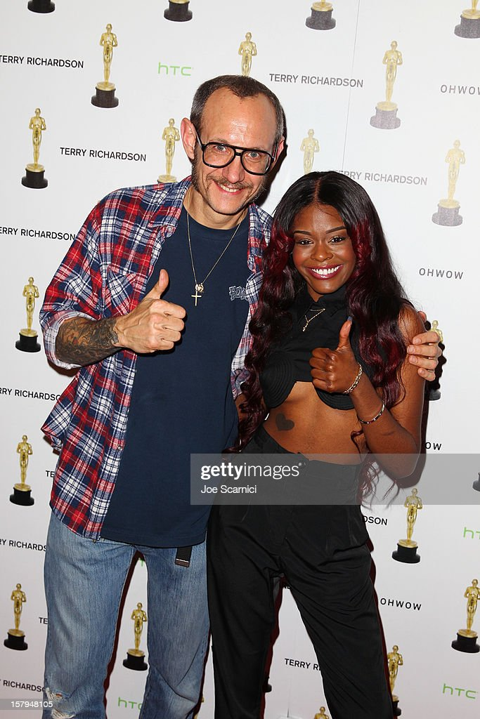 Photographer <a gi-track='captionPersonalityLinkClicked' href=/galleries/search?phrase=Terry+Richardson&family=editorial&specificpeople=758714 ng-click='$event.stopPropagation()'>Terry Richardson</a> and <a gi-track='captionPersonalityLinkClicked' href=/galleries/search?phrase=Azealia+Banks&family=editorial&specificpeople=8607708 ng-click='$event.stopPropagation()'>Azealia Banks</a> attend the after party for the OHWOW & HTC celebration of the release of 'TERRYWOOD', sponsored by GQ and Disaronno at The Standard Hotel & Spa on December 7, 2012 in Miami Beach, Florida.