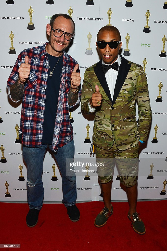 Photographer Terry Richardson and Pharrell Williams attend the OHWOW & HTC celebration of the release of 'TERRYWOOD' at The Standard Hotel & Spa on December 7, 2012 in Miami Beach, Florida.