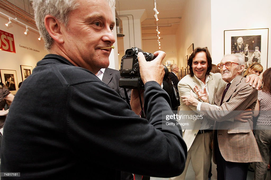 Photographer <a gi-track='captionPersonalityLinkClicked' href=/galleries/search?phrase=Thurston+Hopkins&family=editorial&specificpeople=839820 ng-click='$event.stopPropagation()'>Thurston Hopkins</a> (R) poses for a photograph with Matthew Butson at the Getty Images Gallery during the private view of the Picture Post exhibition on May 24, 2007 in London. After fifty years since the last issue of the British weekly photo magazine, the exhibition has assembled a selection of images from the publication's 19-year history.