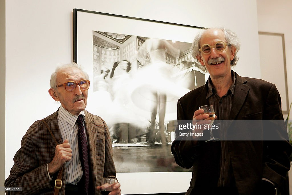 Photographer <a gi-track='captionPersonalityLinkClicked' href=/galleries/search?phrase=Thurston+Hopkins&family=editorial&specificpeople=839820 ng-click='$event.stopPropagation()'>Thurston Hopkins</a> (L) talks to photo editor Colin Jacobson at the Getty Images Gallery during the private view of the Picture Post exhibition on May 24, 2007 in London. After fifty years since the last issue of the British weekly photo magazine, the exhibition has assembled a selection of images from the publication's 19-year history.