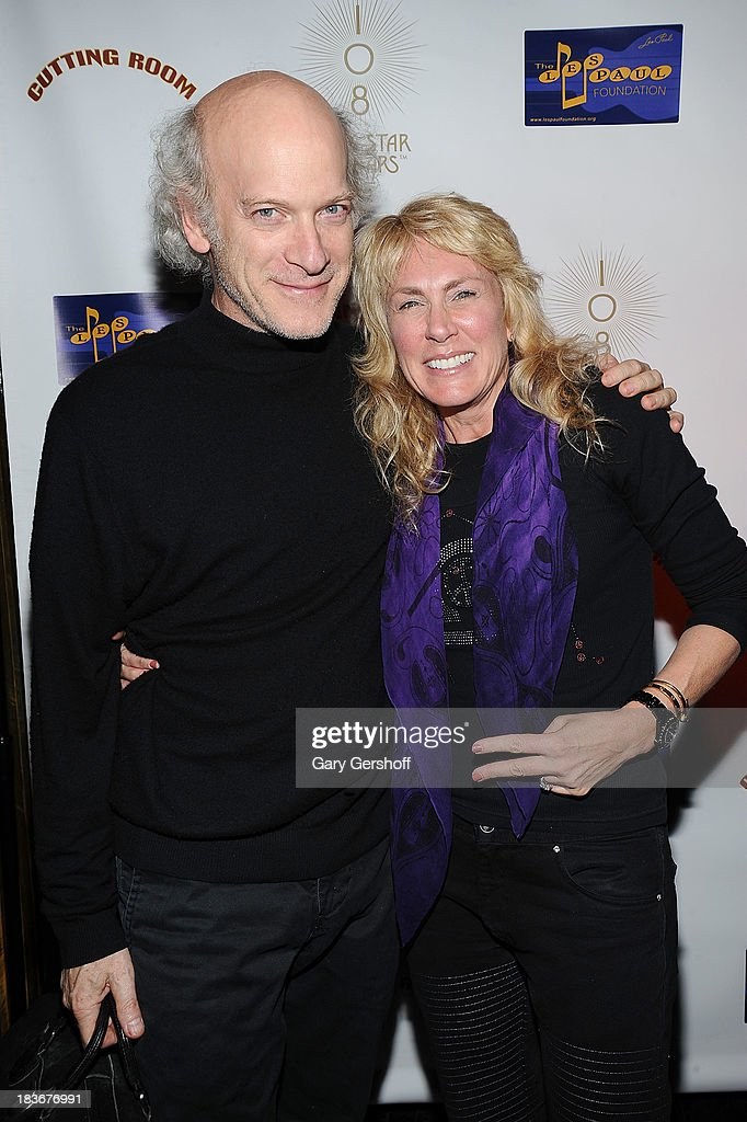Photographer Timothy Greenfield-Sanders (L) and author and photographer Lisa Johnson attend the book launch and performance for '108 Rock Star Guitars' benefitting The Les Paul Foundation at The Cutting Room on October 8, 2013 in New York City.