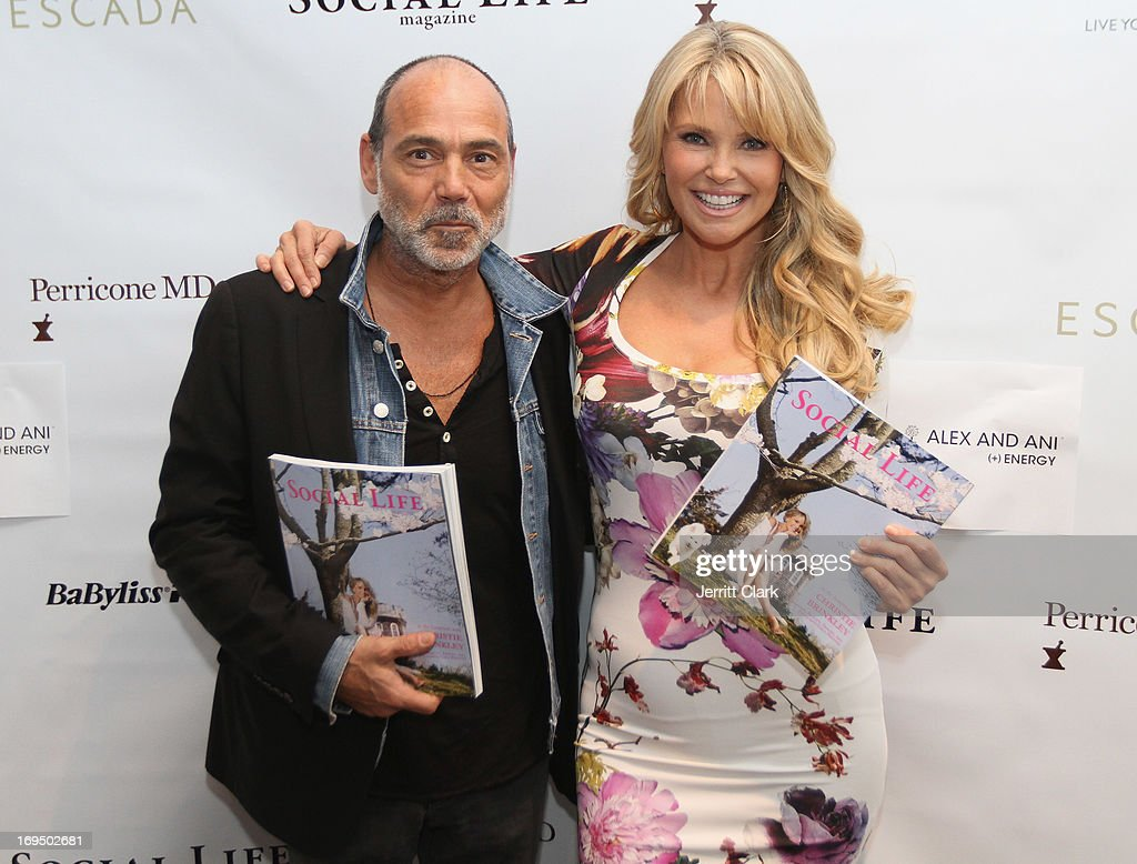 Photographer Timothy White and <a gi-track='captionPersonalityLinkClicked' href=/galleries/search?phrase=Christie+Brinkley&family=editorial&specificpeople=204151 ng-click='$event.stopPropagation()'>Christie Brinkley</a> attend <a gi-track='captionPersonalityLinkClicked' href=/galleries/search?phrase=Christie+Brinkley&family=editorial&specificpeople=204151 ng-click='$event.stopPropagation()'>Christie Brinkley</a>'s 'Social Life Magazine' Cover Celebration on May 25, 2013 in Water Mill, New York.