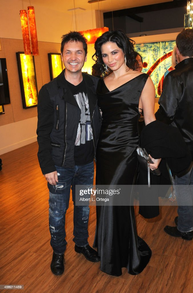 Photographer TJ Scott and actress Katrina Law attend TJ Scott's 'In The Tub' Book Party Launch to benefit UCLA's Jonsson Cancer Center for Breast Research hosted by Katrina Law of 'Spartacus' held at Light In Art on December 12, 2013 in Los Angeles, California.