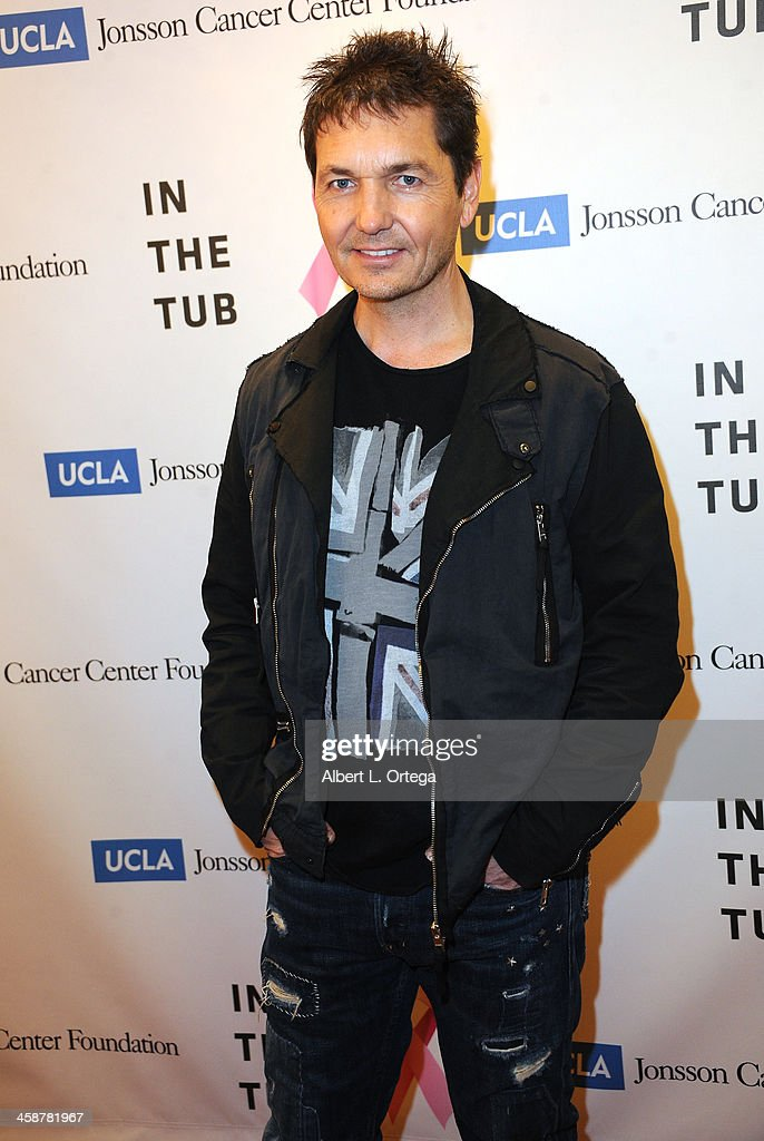 Photographer TJ Scott attends TJ Scott's 'In The Tub' Book Party Launch to benefit UCLA's Jonsson Cancer Center for Breast Research hosted by Katrina Law of 'Spartacus' held at Light In Art on December 12, 2013 in Los Angeles, California.
