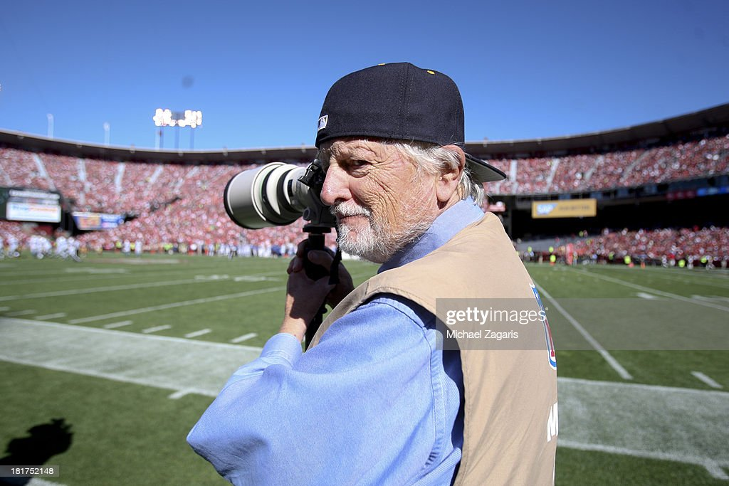 Photographer Tony Tomsic, one of four photographers left that has shot all every Super Bowl, stands on the sidelines during the game between the San Francisco 49ers and the Indianapolis Colts at Candlestick Park on September 22, 2013 in San Francisco, California. The Colts defeated the 49ers 27-7.
