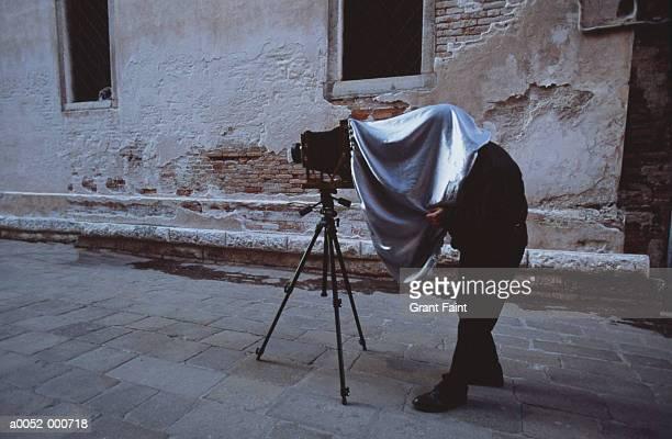 Photographer under Sheet