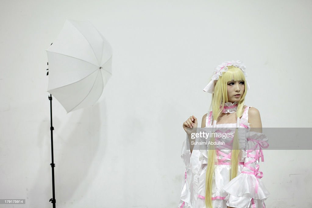 A photographer uses umbrellas to take portraits of cosplayers during the Singapore Toy, Game & Comic Convention (STGCC) at the Sands Expo & Convention Centre at Marina Bay Sands on September 01, 2013 in Singapore. The STGCC attracts thousands of fans who gather to enjoy exhibitions celebrating comics, gaming and movies from both Western and Asian cultures.
