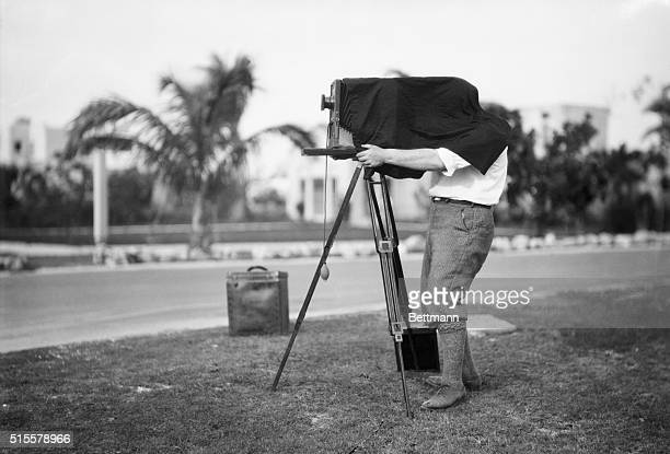 A photographer using a largeformat camera in Florida