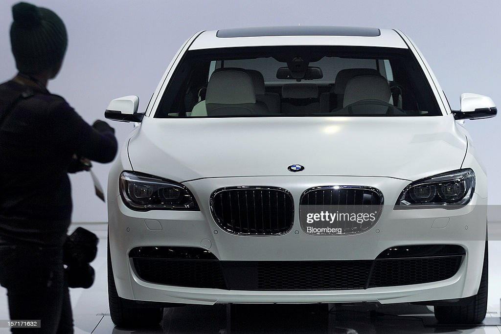A photographer views the 2013 Bayerische Motoren Werke AG (BMW) 750 Li sedan vehicle displayed at the company's booth during the LA Auto Show in Los Angeles, California, U.S., on Thursday, Nov. 29, 2012. The LA Auto Show is open to the public Nov. 30 through Dec. 9. Photographer: Jonathan Alcorn/Bloomberg via Getty Images