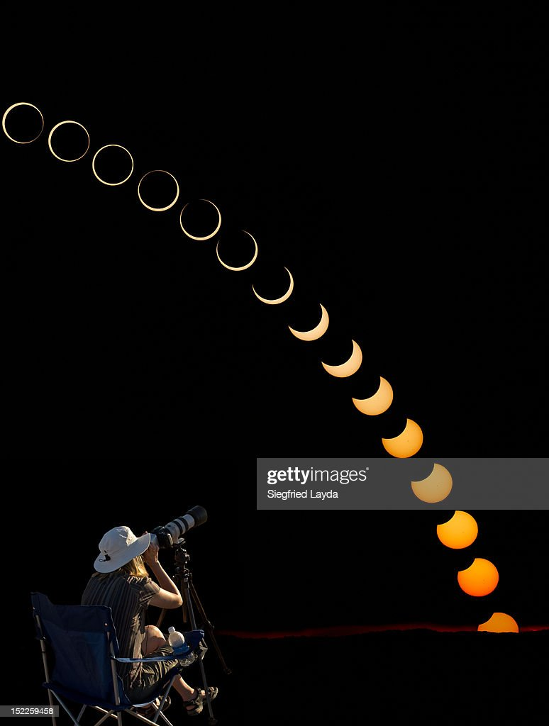 A photographer watches an Annular Eclipse : Stock Photo