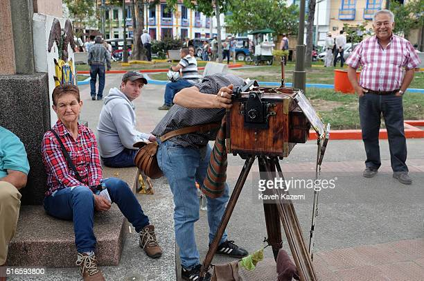 A photographer with a vintage view camera makes snap photos for the visitors on a Sunday in the main town square on January 24 2016 in Filandia...