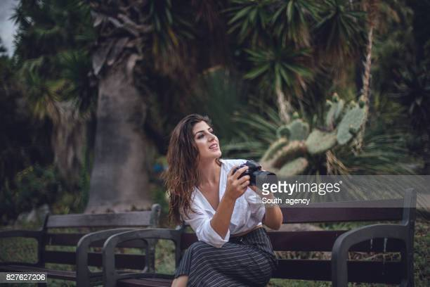 Photographer woman sitting in park