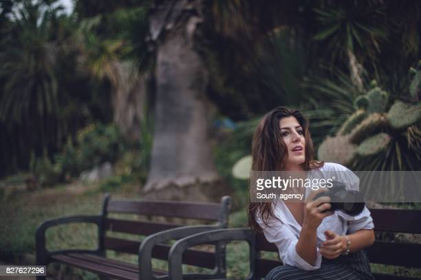 Photographer woman sitting on a bench