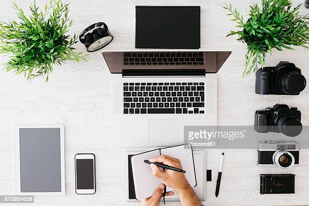 Photographer working at desk , top view