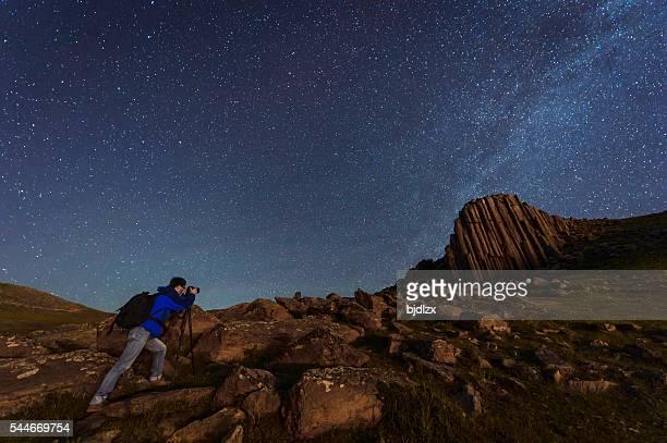 Photographer working under the night sky
